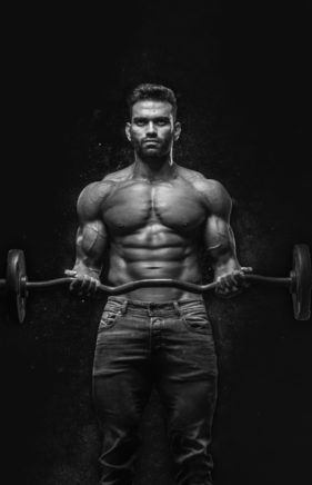 man-holding-barbell-1431282